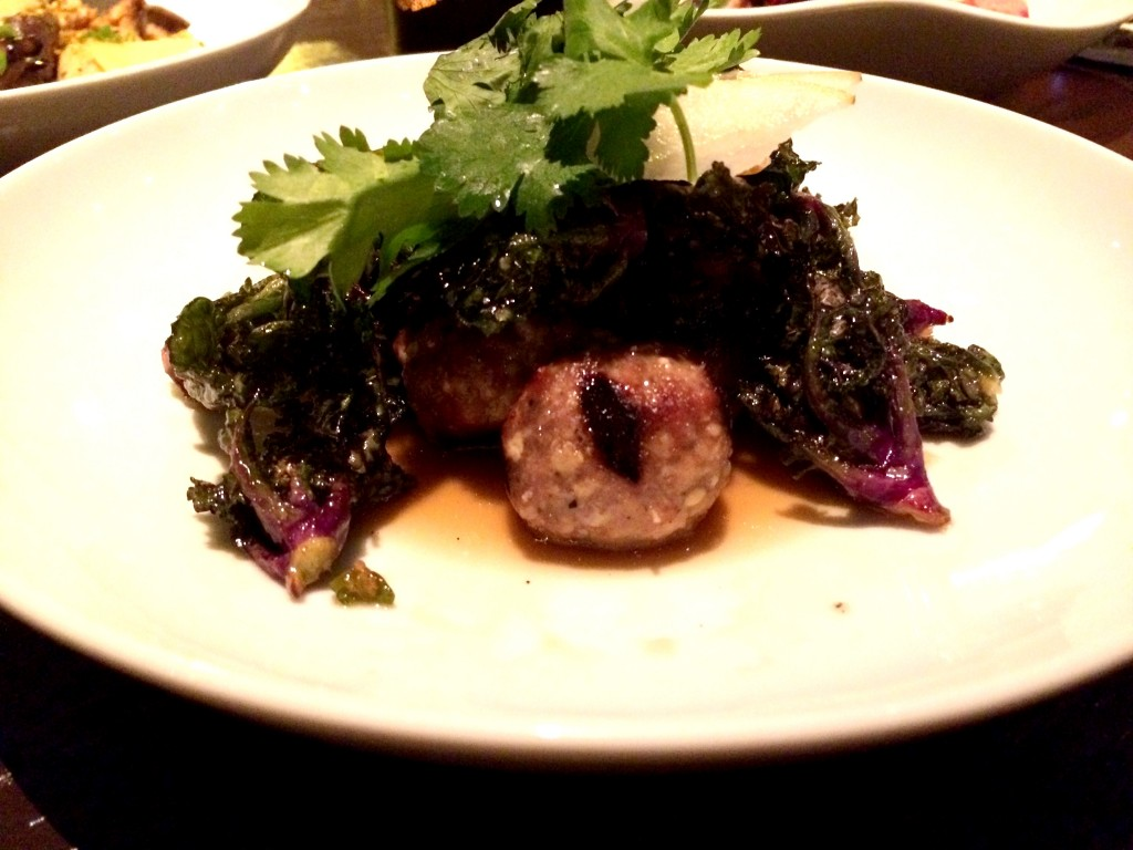 Charred lamb meatballs with kale sprouts, Asian pear and nuoc cham at Embeya Chicago