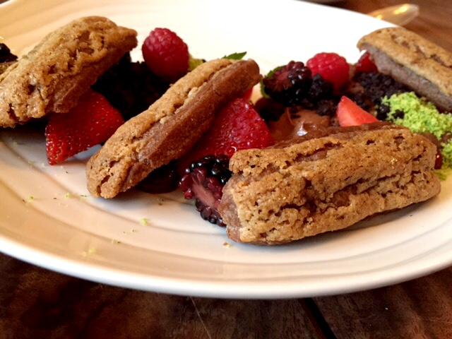 chocolate and coffee eclairs with mixed berries and mint at Petit Crenn