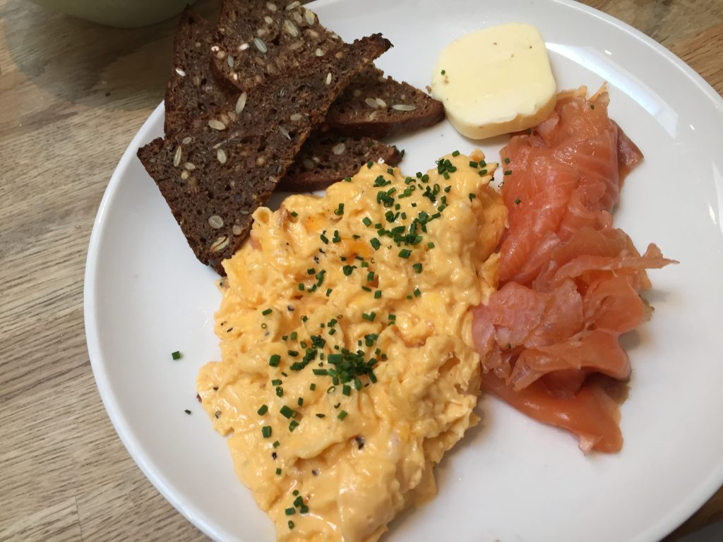 House-Cured Salmon, scrambled eggs, homemade rye bread at Snaps & Rye