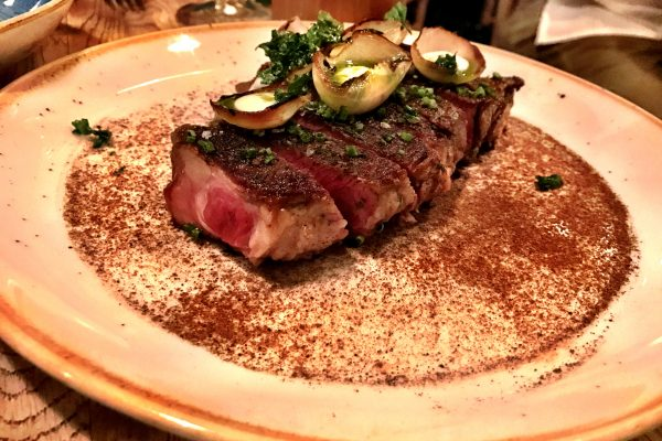 Steak with burnt onion, potatoes, rosemary at Kali Restaurant Los Angeles