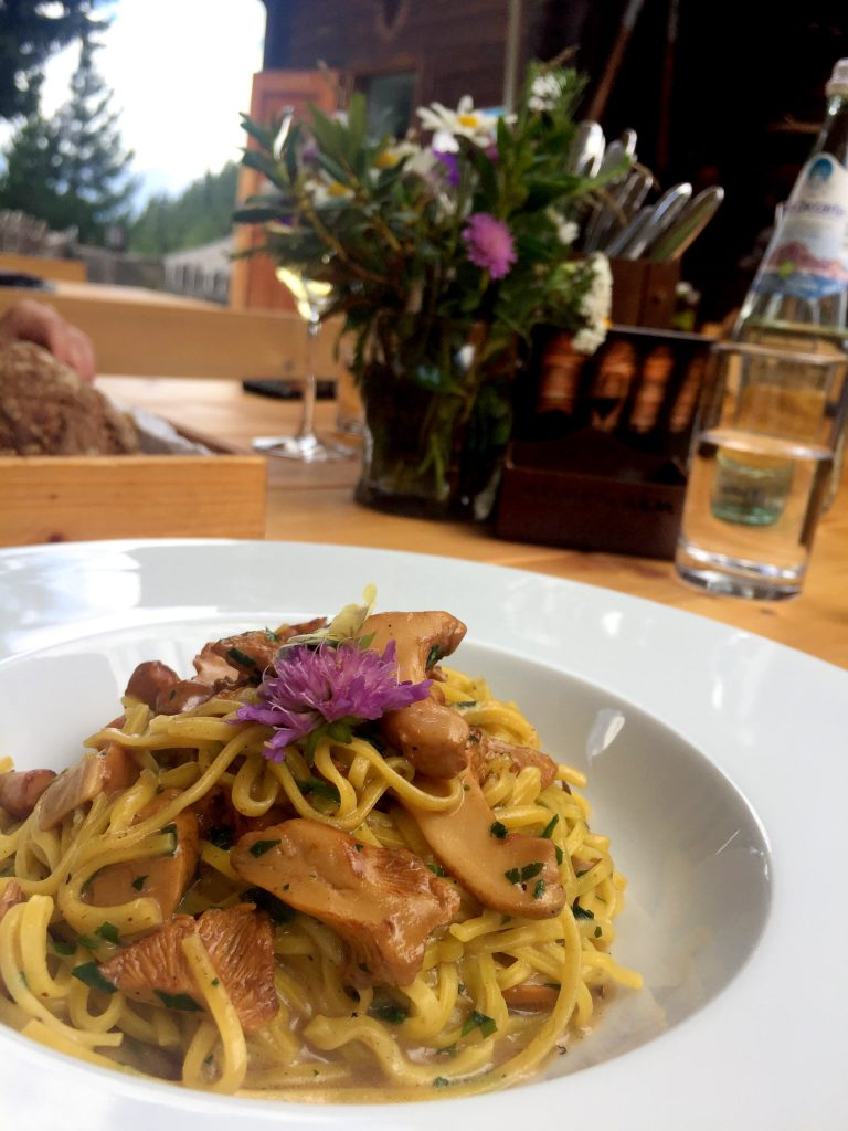 Most amazing chanterelle pasta at Gompm Alm in Tyrol Mountains