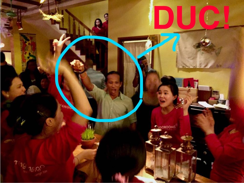 Duc owner of Mango Mango and his happy staff on NYE!